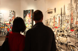 art patrons viewing paintings by Brooke Harker at Jeanie Madsen Gallery