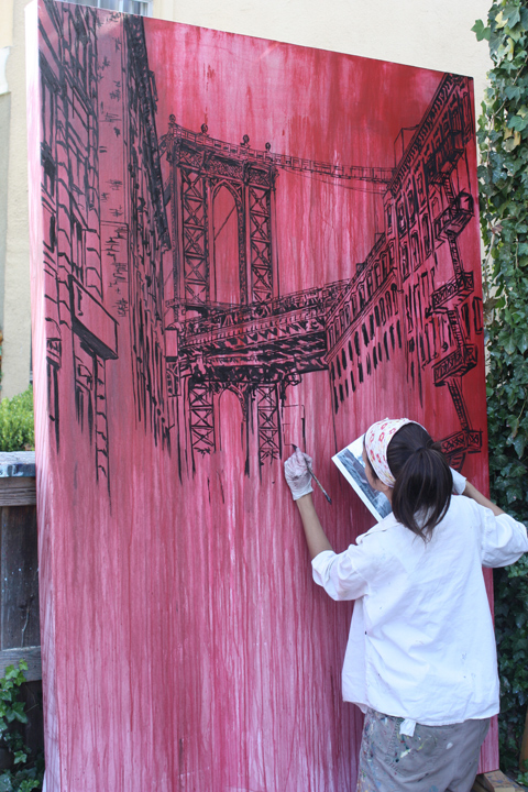 artist Brooke Harker in the process of painting the Manhattan Bridge