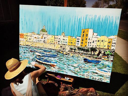 artist painting boats in Sicily