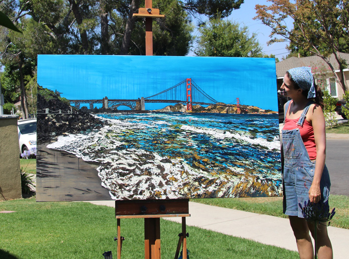 "artist Brooke Harker with her finished ""Golden Gate Shores"""