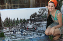 artist Brooke Harker poses with Reflections of Cumbres Pass