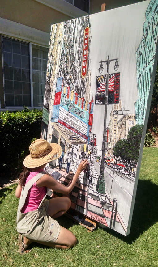 artist painting Broadway in downtown LA by the Orpheum Theatre