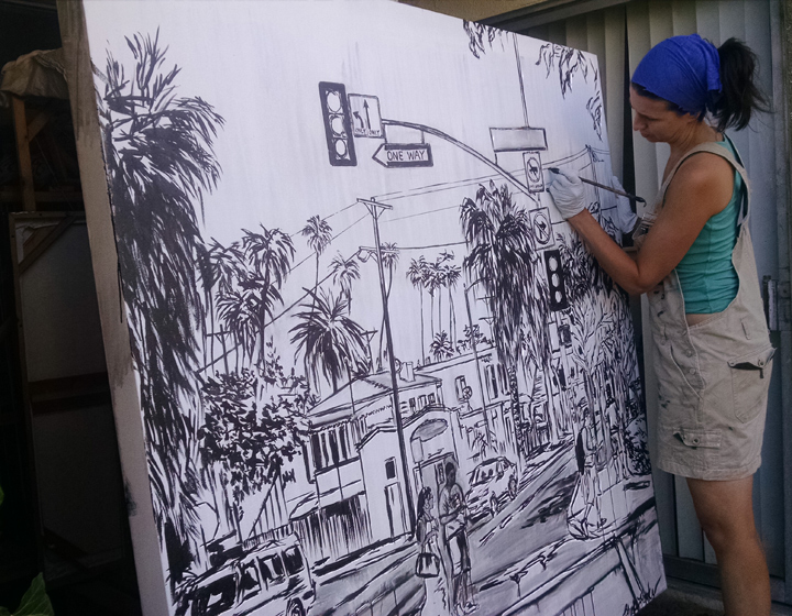 "artist Brooke Harker paints the framework of ""Boulevard Smile"""