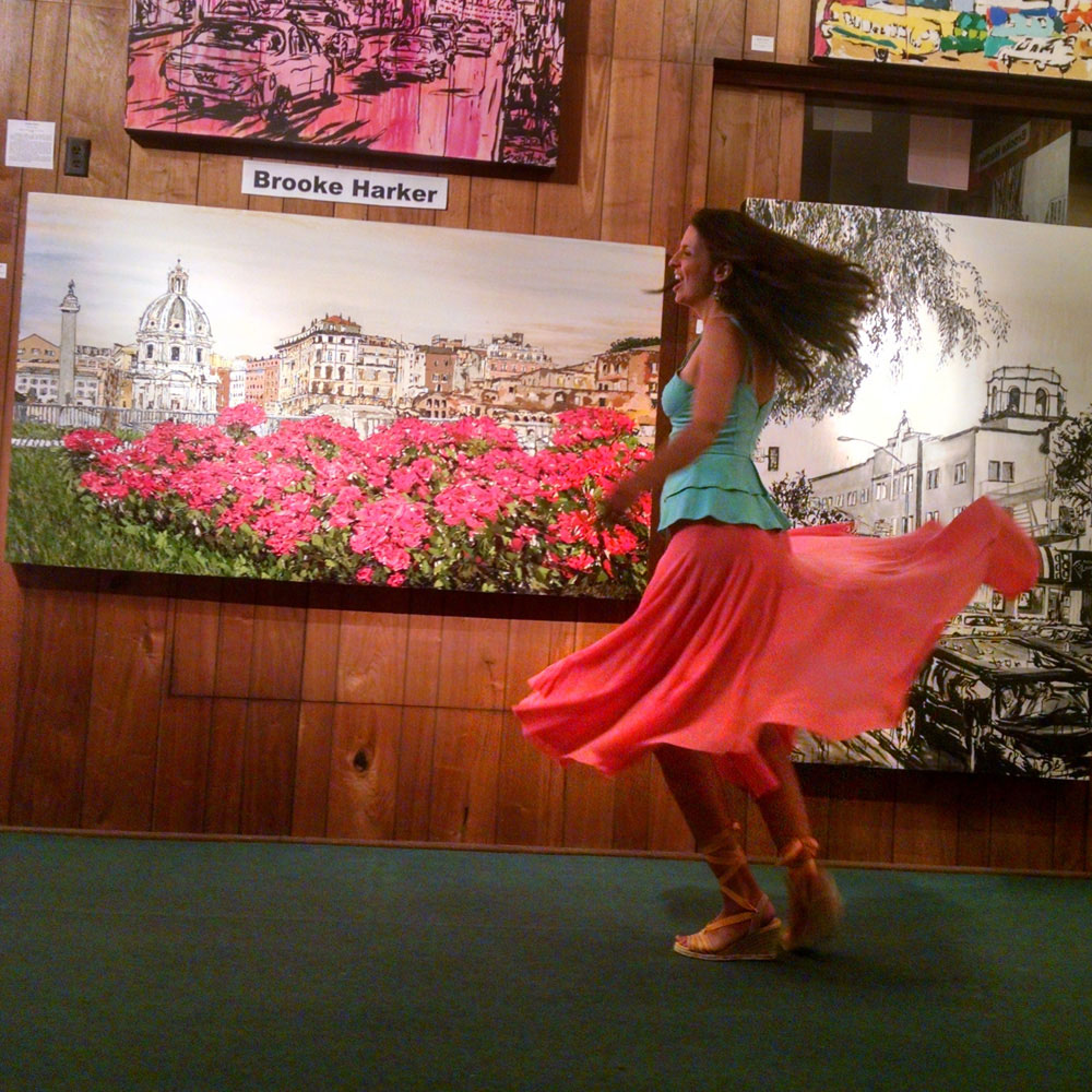 twirling at Lu Martin Galleries in front of Fiori di Roma