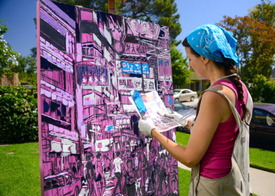Brooke Harker working on a painting of Hong Kong