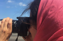 Harker photographing in Cuba