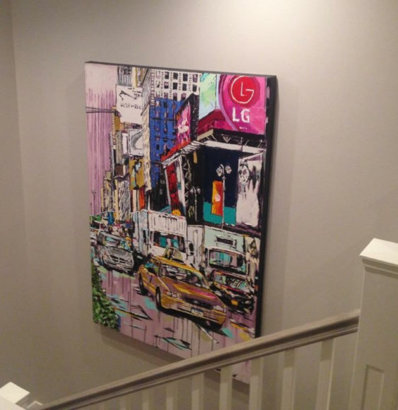 "the vibrant ""Reign of Today"" by Brooke Harker adorns stairwell"