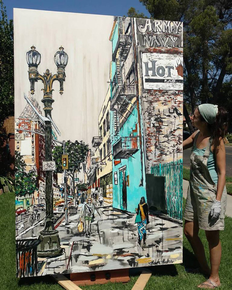 "artist Brooke Harker with the finished ""Downtown Stride"""